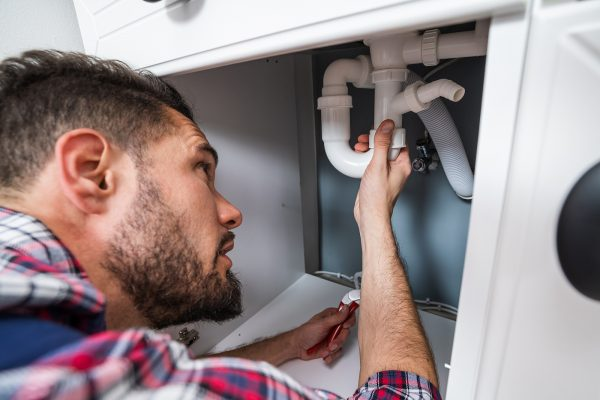 Blocked drains plumber in Canberra fixing the pipe